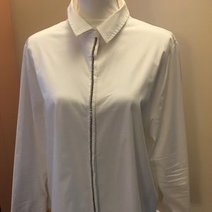 Nice white blouse that is versatile.